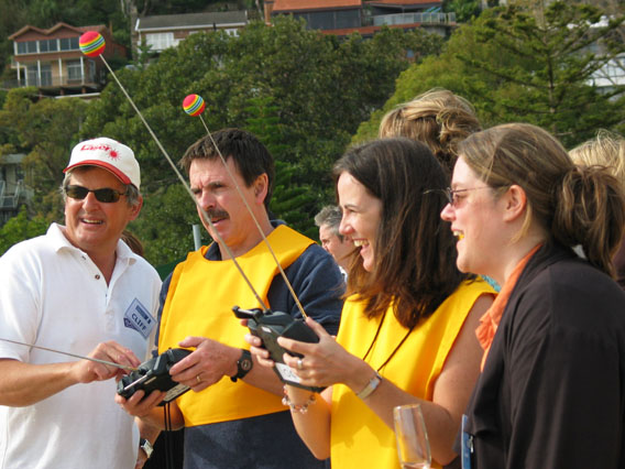 Radio Control Sailing Australia CEO Cliff Bromiley helps a corporate team